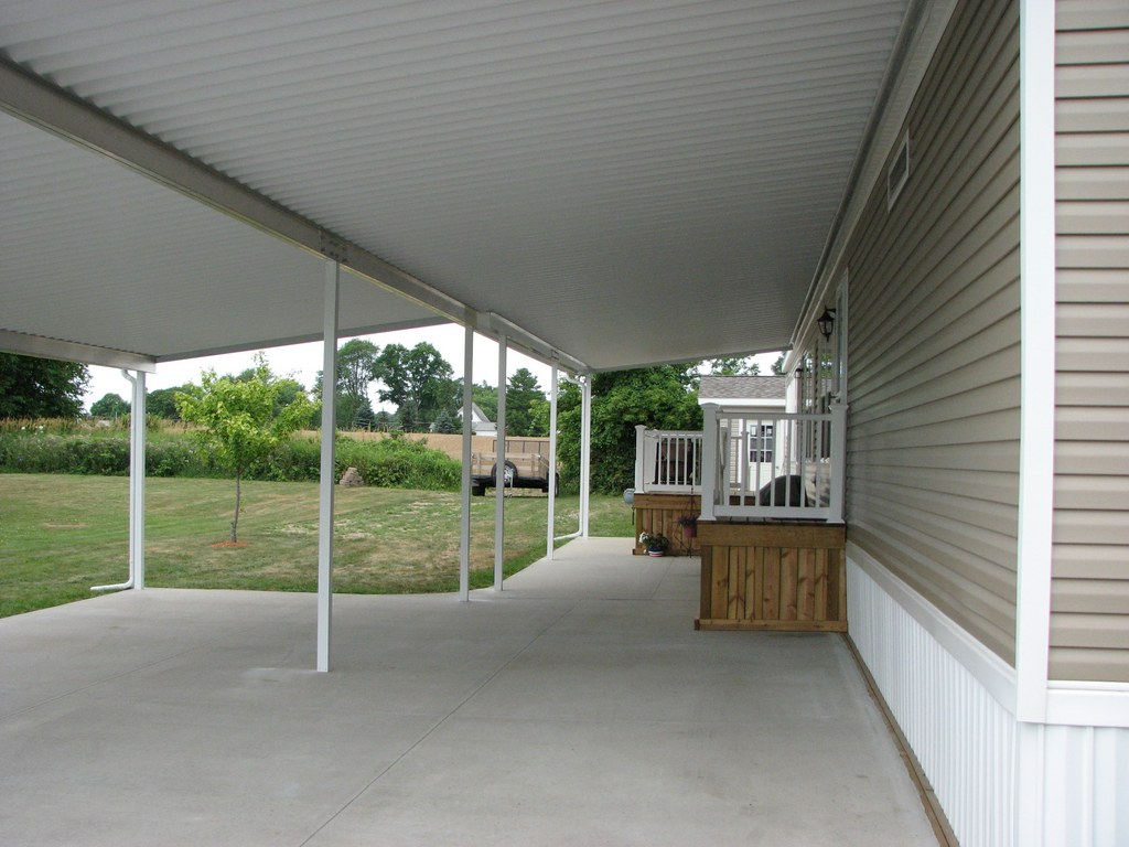 Under the new Carport and patio Cover, including both sets of steps into  the home and the Bar-B-Que Grill! - Porch And Patio Covers